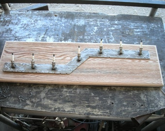 wall mounted hat or coat rack made from reclaimed spark plugs and oak