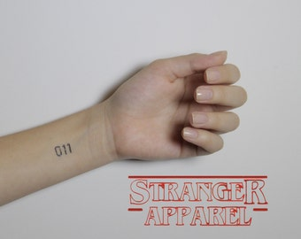 Body jewelry etsy for Eleven tattoo stranger things
