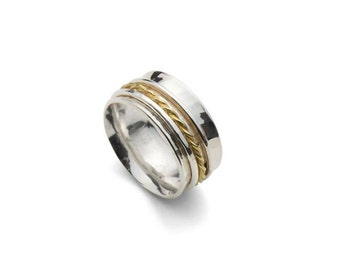 Hand made, sterling silver and 18ct gold spinning ring