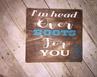 Head over boots sign