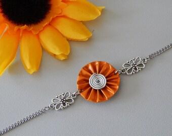 Bracelet with capsules Nespresso Orange pleated flower shape