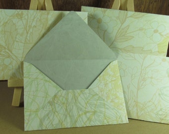 4 A7 Handmade envelopes in cream and powder blue daisy pattern, coloured inside