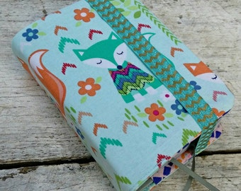 NWT reversible Bible cover, Pastel foxes in sweaters, pocket sized. Mint and coral stripes on reverse. Trees and flowers