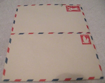 Vintage stamped unused  envelopes Air mail postage 6 cents 1 plane and 1 Eagle