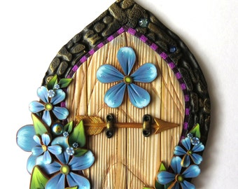 Blue Flower Garden Fairy Door with an Elf Bolt Arrow