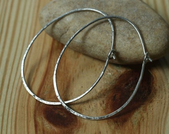 Handmade hammered oval (egg shape) silver tone hoop 42x32mm, one pair (item ID STEGG18GS)