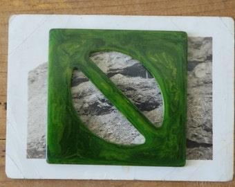 1930s  art deco carved green Bakelite buckle