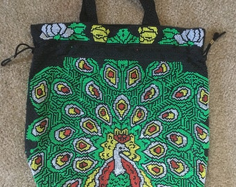 Beaded 1970s peacock top handle tote purse with drawstring.