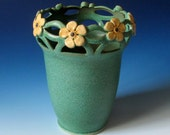 Art Nouveau / Arts and Crafts style vase with cut out rim and floral design