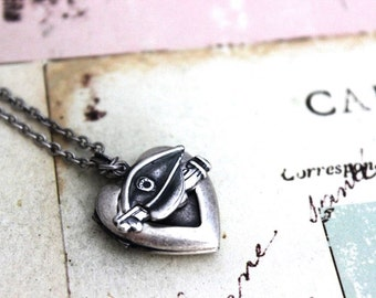 police. heart locket necklace. in silver ox jewelry with hat and car charms