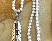 Carved bone feather and grey pearl pendant necklace