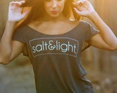 Salt & Light. Off the Shoulder Flutter Sleeve Flowy Muscle Tee. Made in the USA. Sizes S-XL.  Off the Shoulder Lounge Tee.