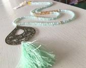 Boho Tassel and Brass Filigree Necklace in Mint Green Crystals, Vintage Wood, and Rhinestones