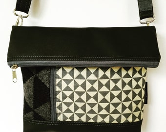 Cross body zipped flap bag in grey or black featuring geometric fabric