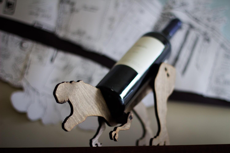 Wine o saur wooden dinosaur wine rack tyrannosaurus rex - Dinosaur wine holder ...