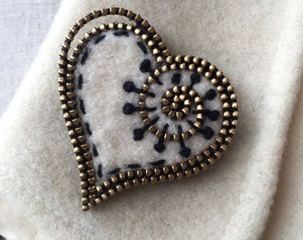 Antique white felt and zipper heart brooch