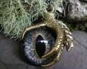 Gothic Steampunk Single Claw Pendant with Soft Gray Black Eye
