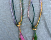 Pair of handmade curtain tie backs with tassels, necklaces, garland