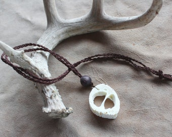 Goat bone necklace on hand-braided brown hemp cord and wooden bead