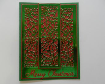 Handmade Greeting card Christmas with holly and berries in green and red.