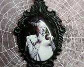 Bride of Frankenstein putting on make-up set in ornate pendant