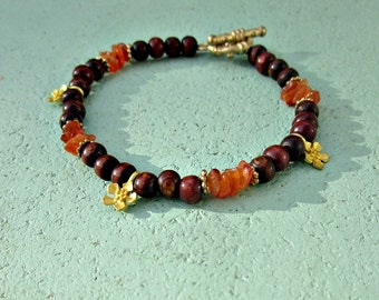 Dark Wood and Orange Carnelian Chip Beaded Toggle Clasp Bracelet with Flower Accents: Camilla
