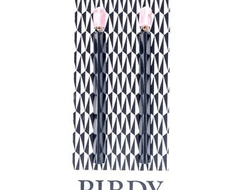 Handmade large long chandelier drop facet geometric statement dangle resin earrings in pastel pink and black.