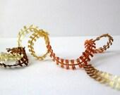 bowtie ribbon yarn . sasparilla . ice yarns 109 yd . copper brown gold champagne . mini butterfly flag fancy novelty yarn . discount destash