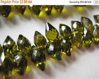 Faceted  Olive Green CZ, Micro Faceted Dagger Briolettes.  6-7mm.  Packet of 2. (2CZ) Reduced from 3.60