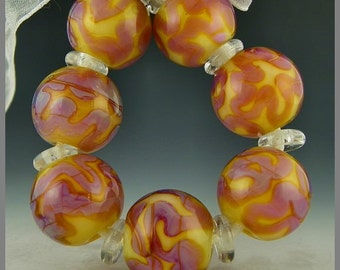 a set of 7 rounds done in pearly pink and purple scrollwork handmade lampwork glass beads - Heatwave