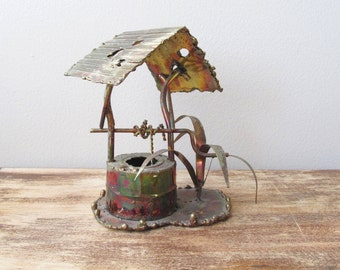 rustic wishing well wagon wheel sign brutalist welded metal sculpture enesco imports