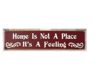 Home is not a place it's a feeling primitive wood sign