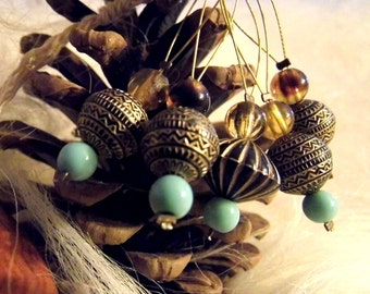 Snag free stitch markers, Aztec design, golds, turquoise, amber. Pretty and useful. Knitting.