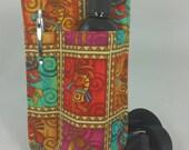 Massage therapy single bottle holster, RIGHT hip, pen pocket, Kokopeli print, black belt
