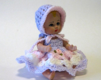 "Doll 5"" tiny girl full porcelain cast from a vintage mold and dressed in a crocheted dress with a matching  pocketbook"