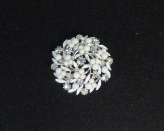 Silver tone metal with white Enamel,Milk Glass beads, AB Rhinestones Brooch Signed ART.