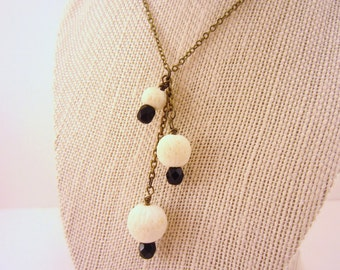 Y necklace. Drop necklace. Black and white necklace. Bronze chain. White pottery beads, black Czech glass beads. Wire wrap. Gift for women.
