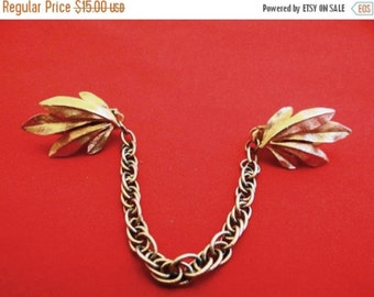 """20% off sale Vintage 6.5"""" gold tone sweater guard with leaf design in great condition"""