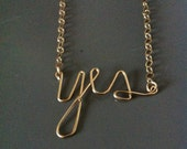Gold Yes necklace