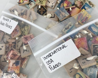 Bags of movies and places, etc scrabble tile pendants - Destash Sort  - some with bails and some without - shipped priority mail