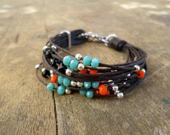 Cord bracelet with blue green and orange crystals, beaded bracelet, fiber jewelry, multicord bracelet handmade in Italy