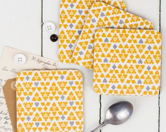 Suits Coasters, playing card motifs, mustard and grey with a white background, placemat from our dime range, fun, yellow pattern