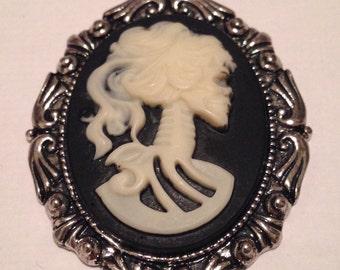 Silver framed skeleton cameo charm