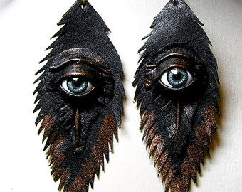 Evil eye black antiqued leather feather earrings. Handmade feather earrings. Halloween earrings. Horror earrings. Wicked Fashion