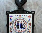 RESERVED Vintage Cast Iron Trivet with Rooster and  Dutch Motif on Tile