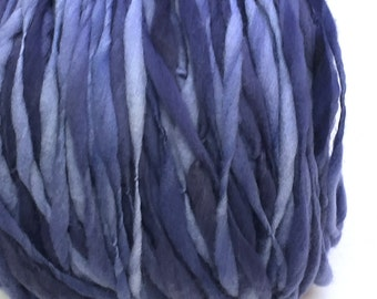 Handspun yarn, 100 yards and 3.25 ounces/ 92 grams spun thick and thin in hand dyed merino wool