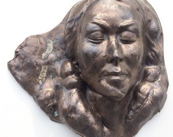 Wall hanging face sculpture, stoneware art mask, portrait of a woman with bronze glaze