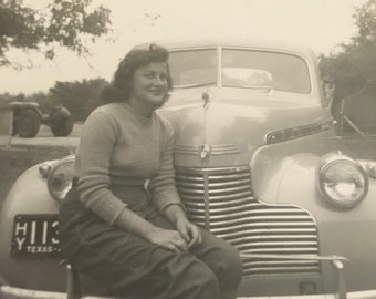 One hell of a bumper! Pretty girl on vintage automobile. San Antonio Tx April 1948. 3 x 5 approx.