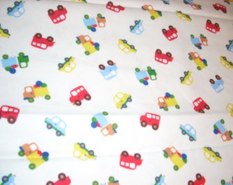 "Cars and Trucks on White -  Flannel Fabric  - 30"" in length by  43"" wide"