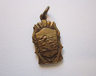 vintage swimming medal